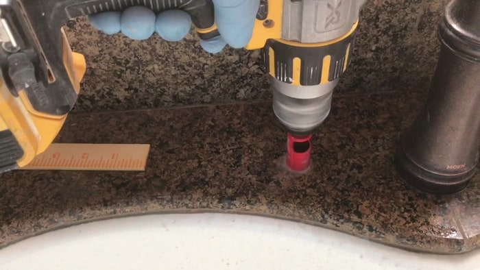 Drill the holes for mounting your sink