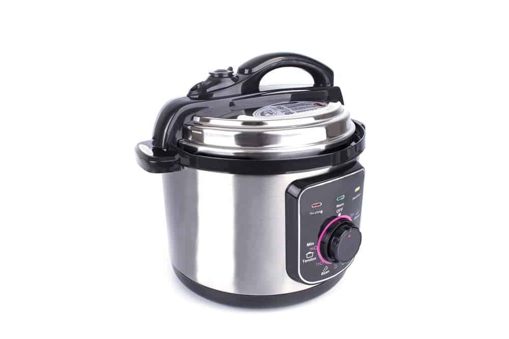 A sideview angle of a rice cooker in a white background.