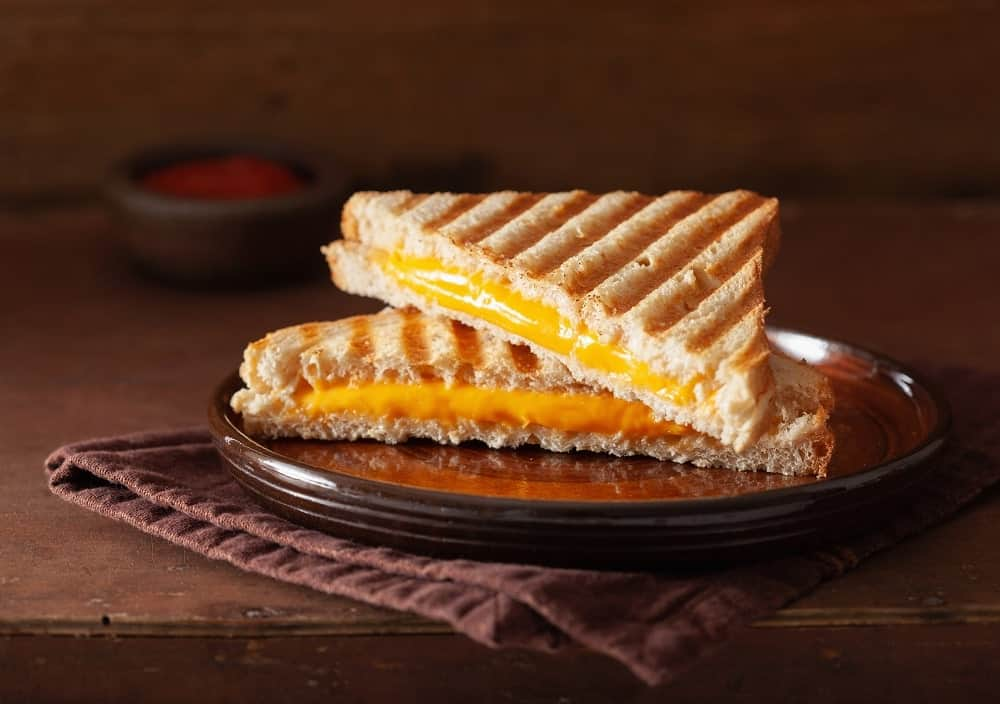 A cheese toastie sandwich on a plate.